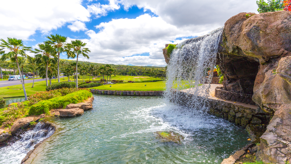 View of a waterfall on the course at Ko Olina Golf Club